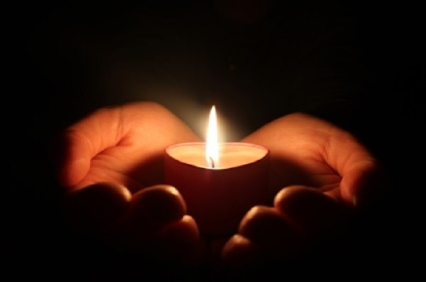 candle and hand