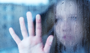 woman-looking-through-rainiy-window
