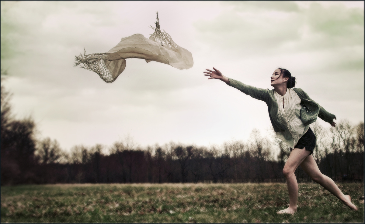fleeting-past-woman-and-windy-day