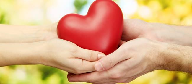 hands-passing-heart
