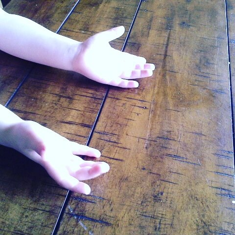 open hands on floor