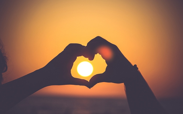 heart hands and sunset