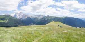 Man and woman mountain biking, Dolomites, Italy