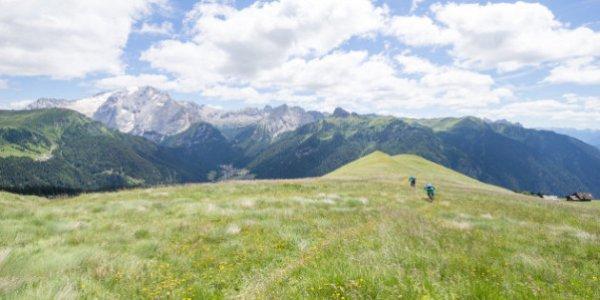 Man and woman mountain biking, Dolomites, Italy