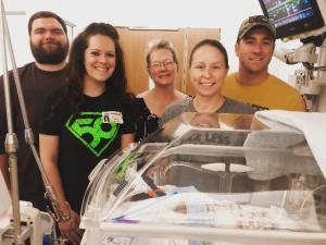 ryker and family around incubator