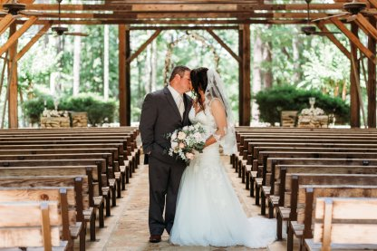 fiona wedding couple kissing in empty chapel