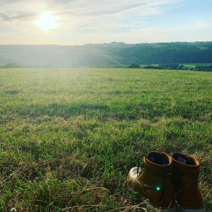 empty boots in field