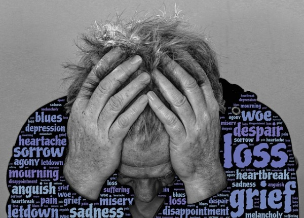 grief head in hands and stress words